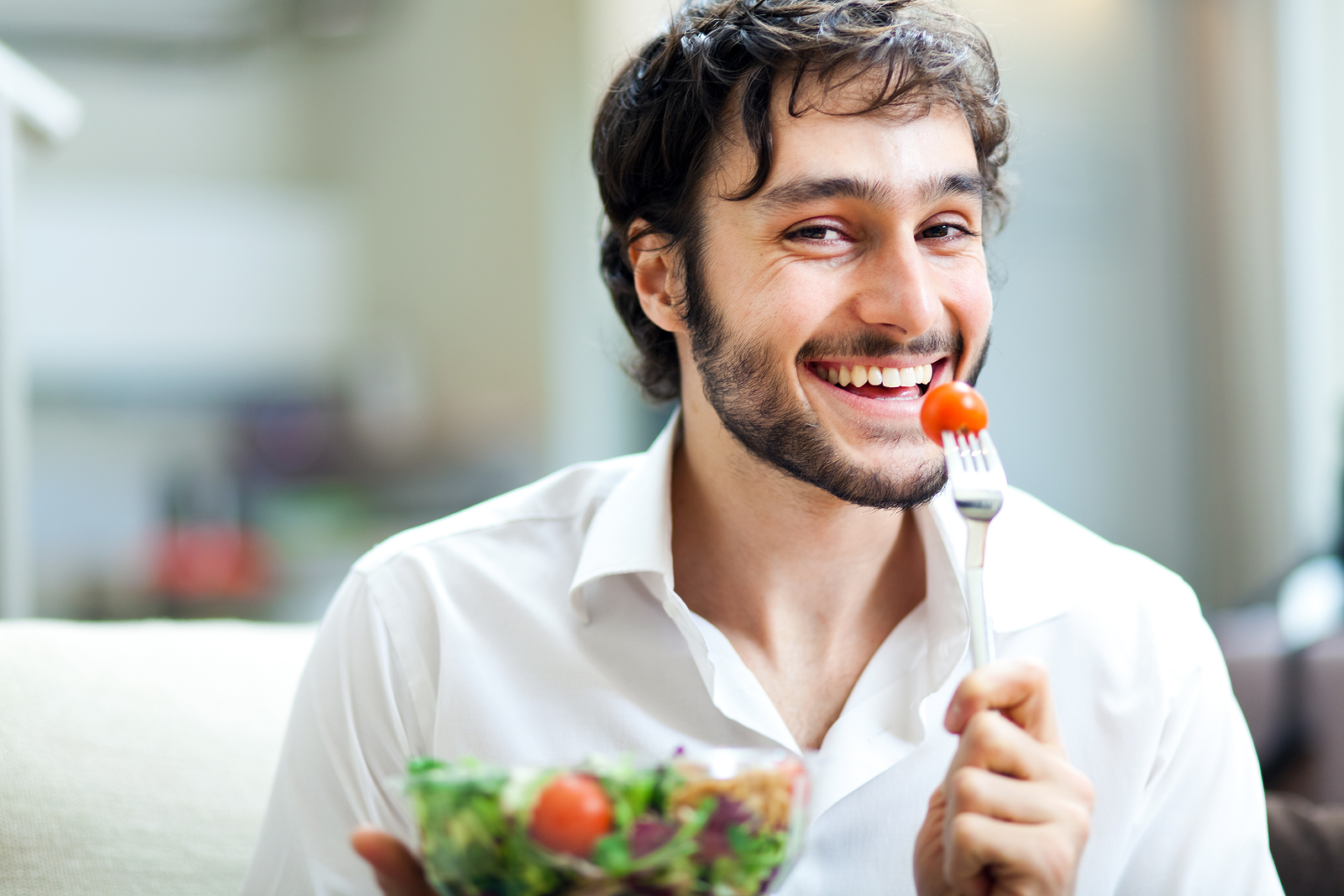 bigstock-Young-man-eating-a-healthy-sal-